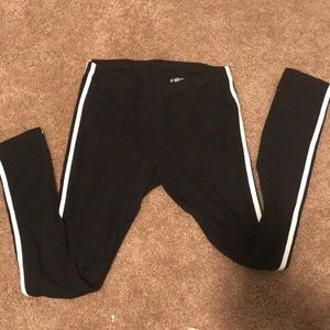 Black leggings with two white stripes on the side